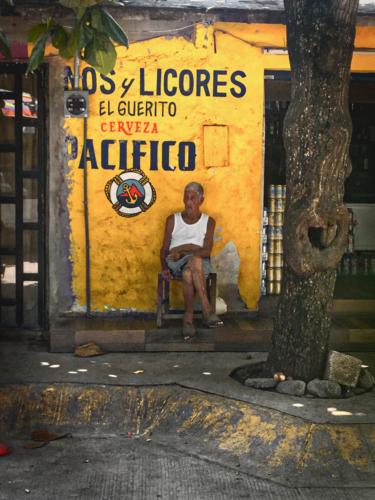 Man in chair, Sayluita, Mexico